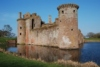 Dumfriesshire's impressive Caerlaverock Castle.  The castle's towers stand above a water-filled moat.